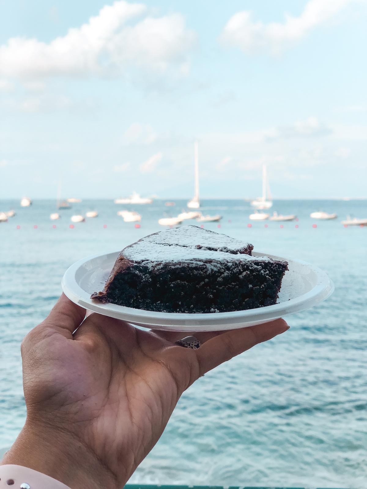 a generous chocolate almond capri cake slice