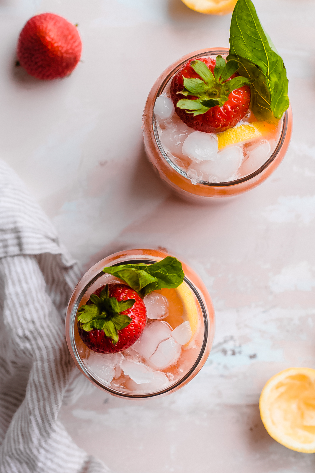 top shot of cold glasses of strawberry lemonade