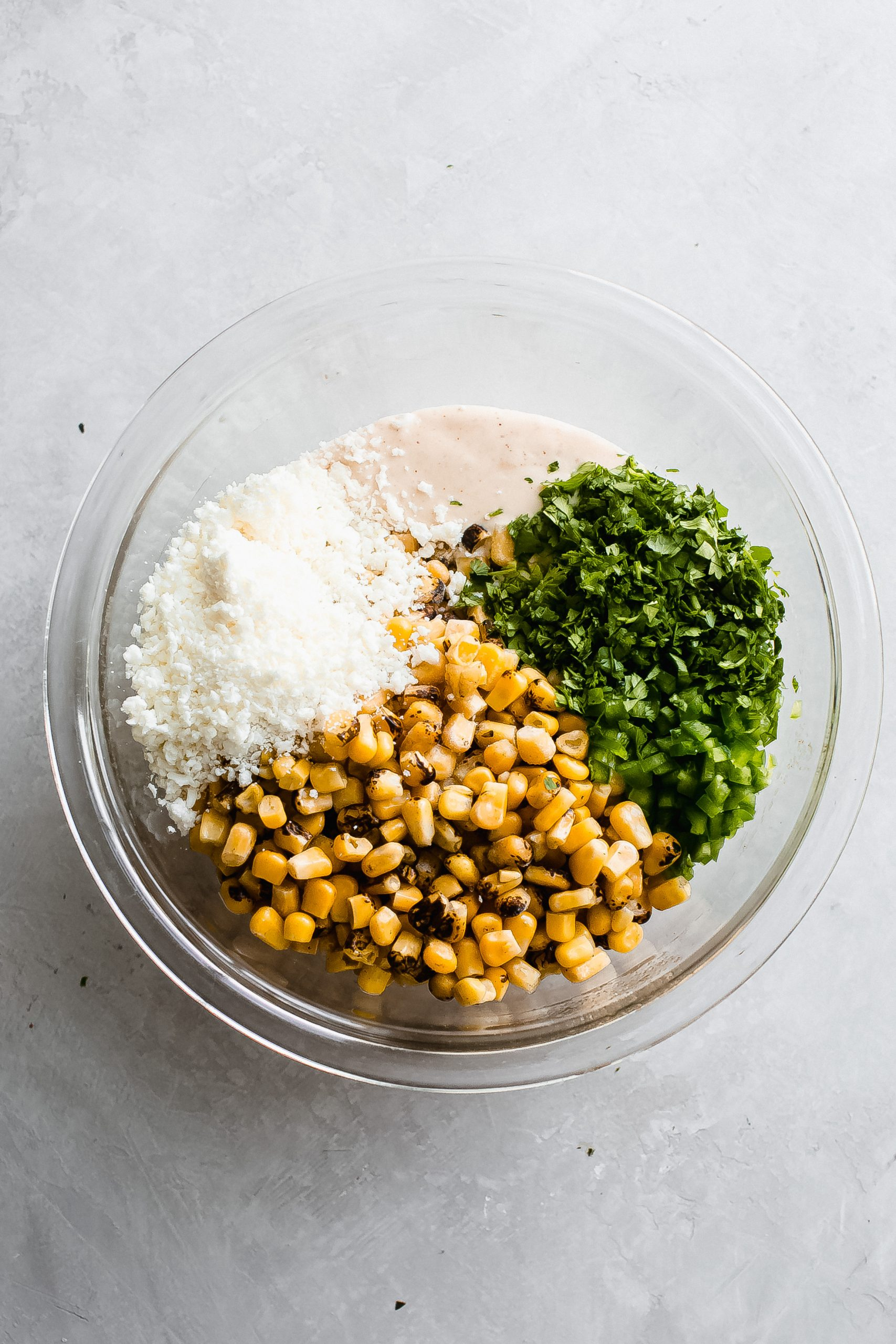 bowl with all the ingredients for Mexican corn dip