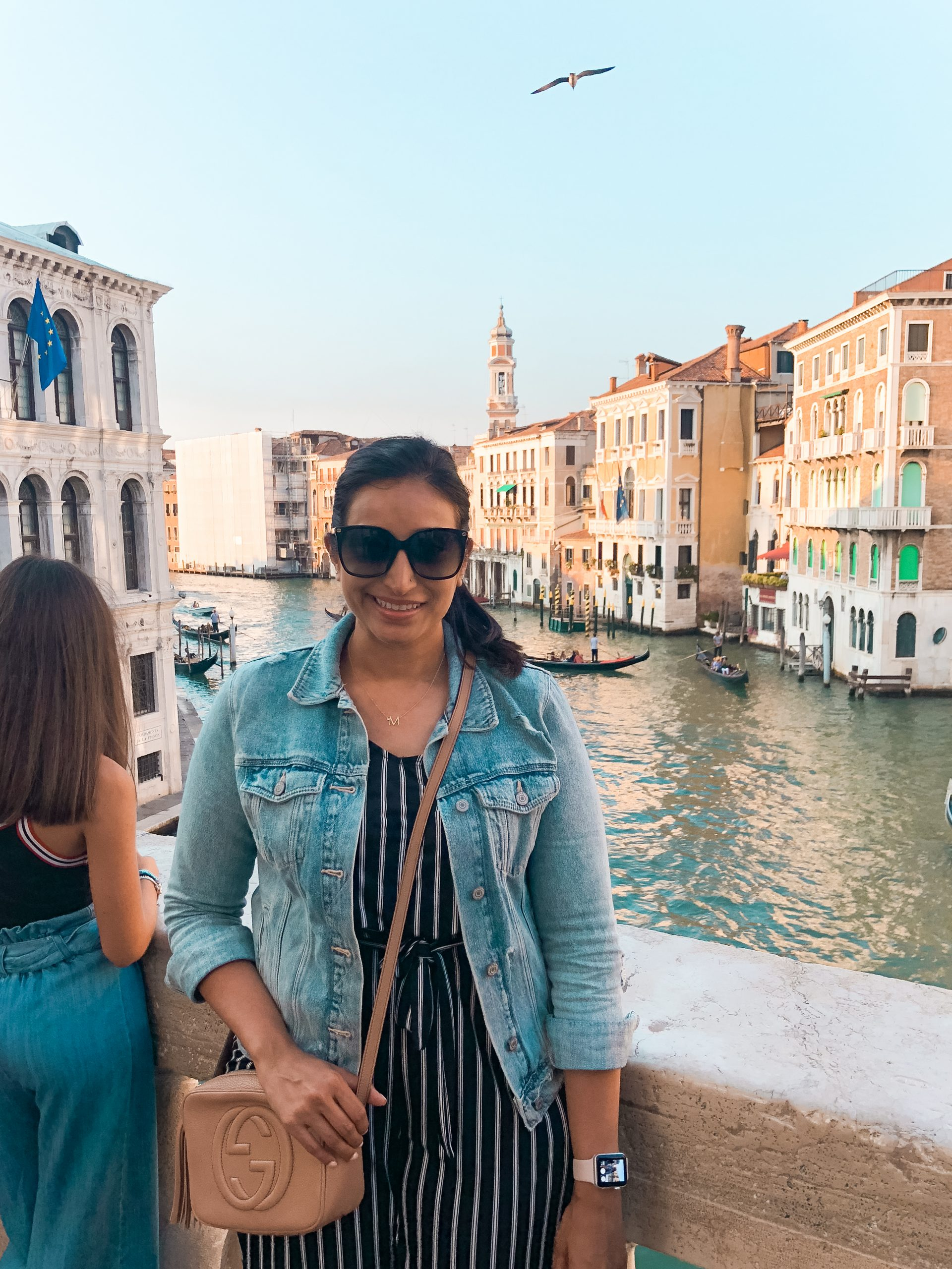 a picture of me with the canals and a gondola in the background