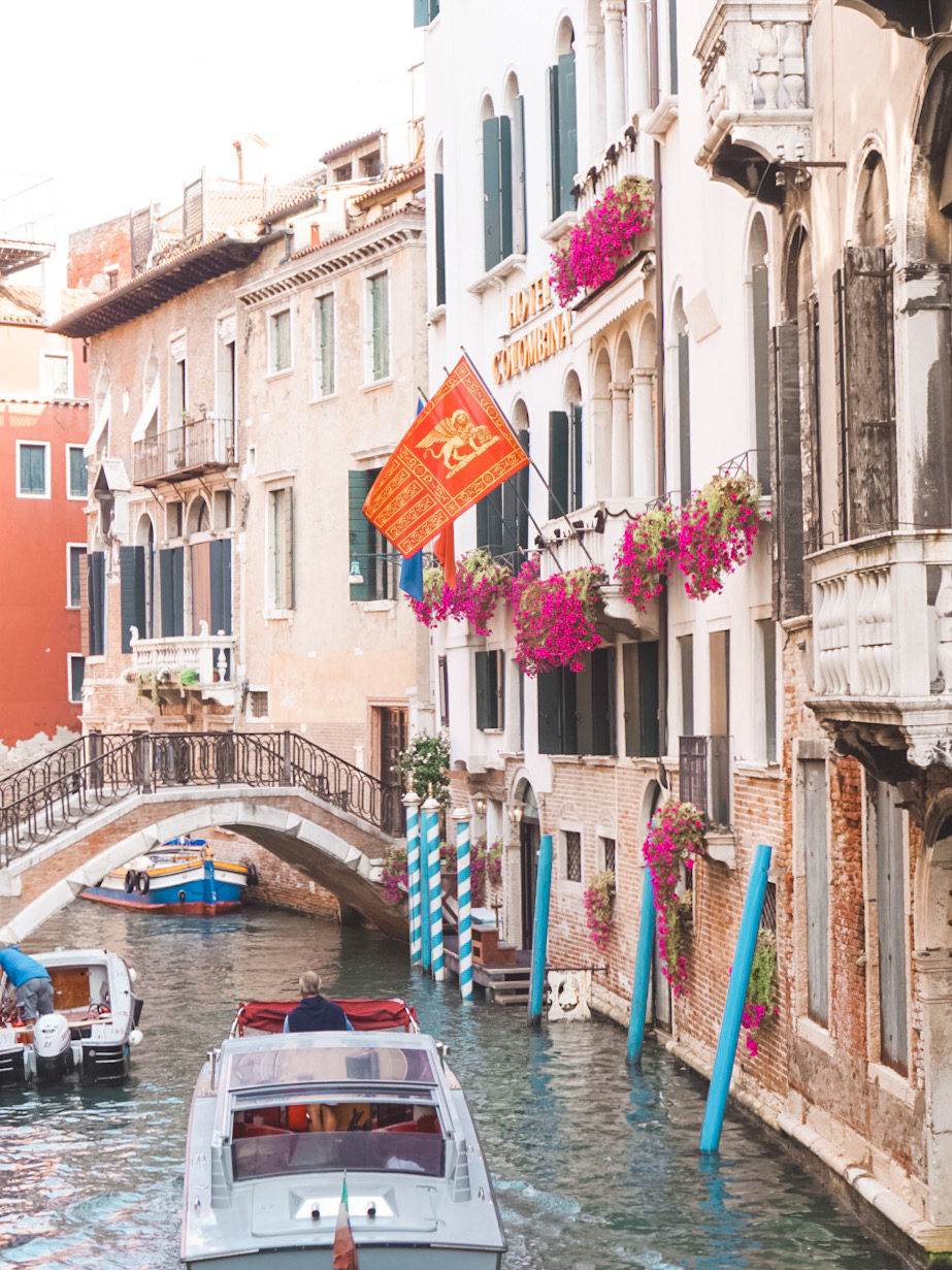 boats of narrow canals in Venice