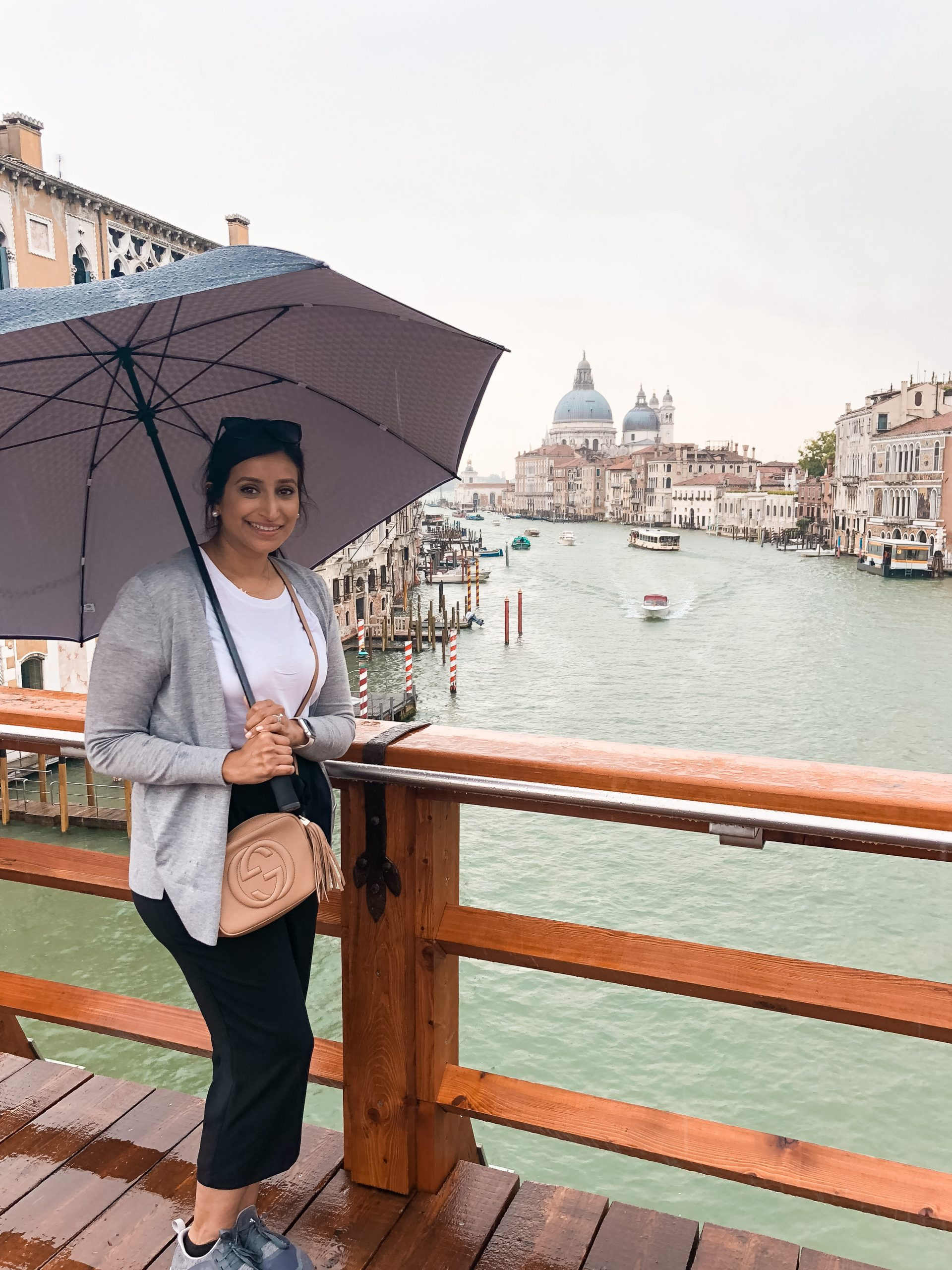 a picture of me with an umbrella with Gallerie dell'Accademia in the background