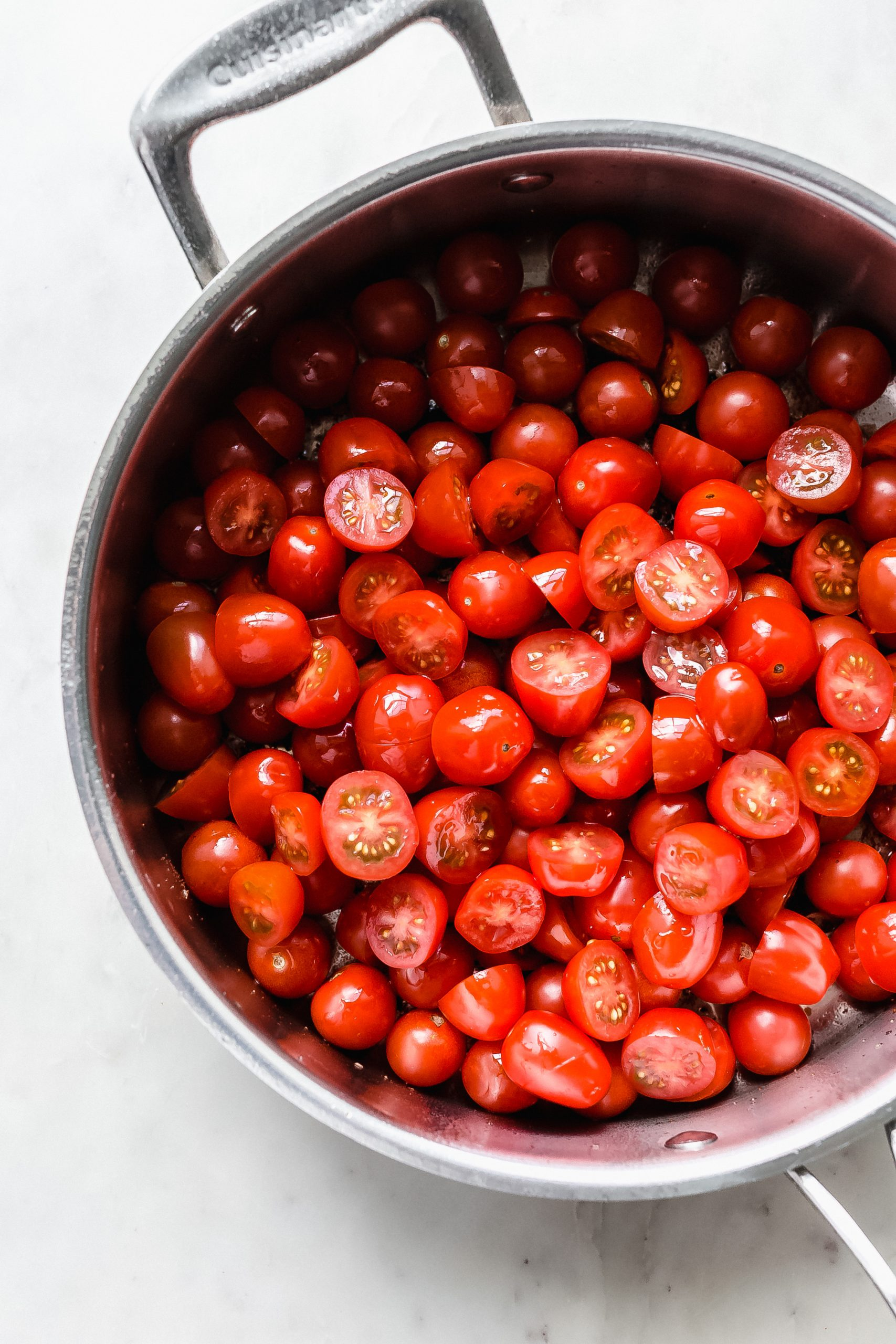 chopped tomatoes in a large saute pan