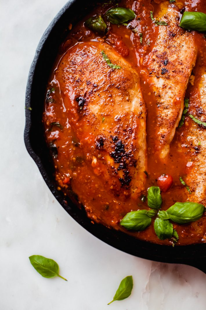 showing browned chicken filet in tomato basil sauce