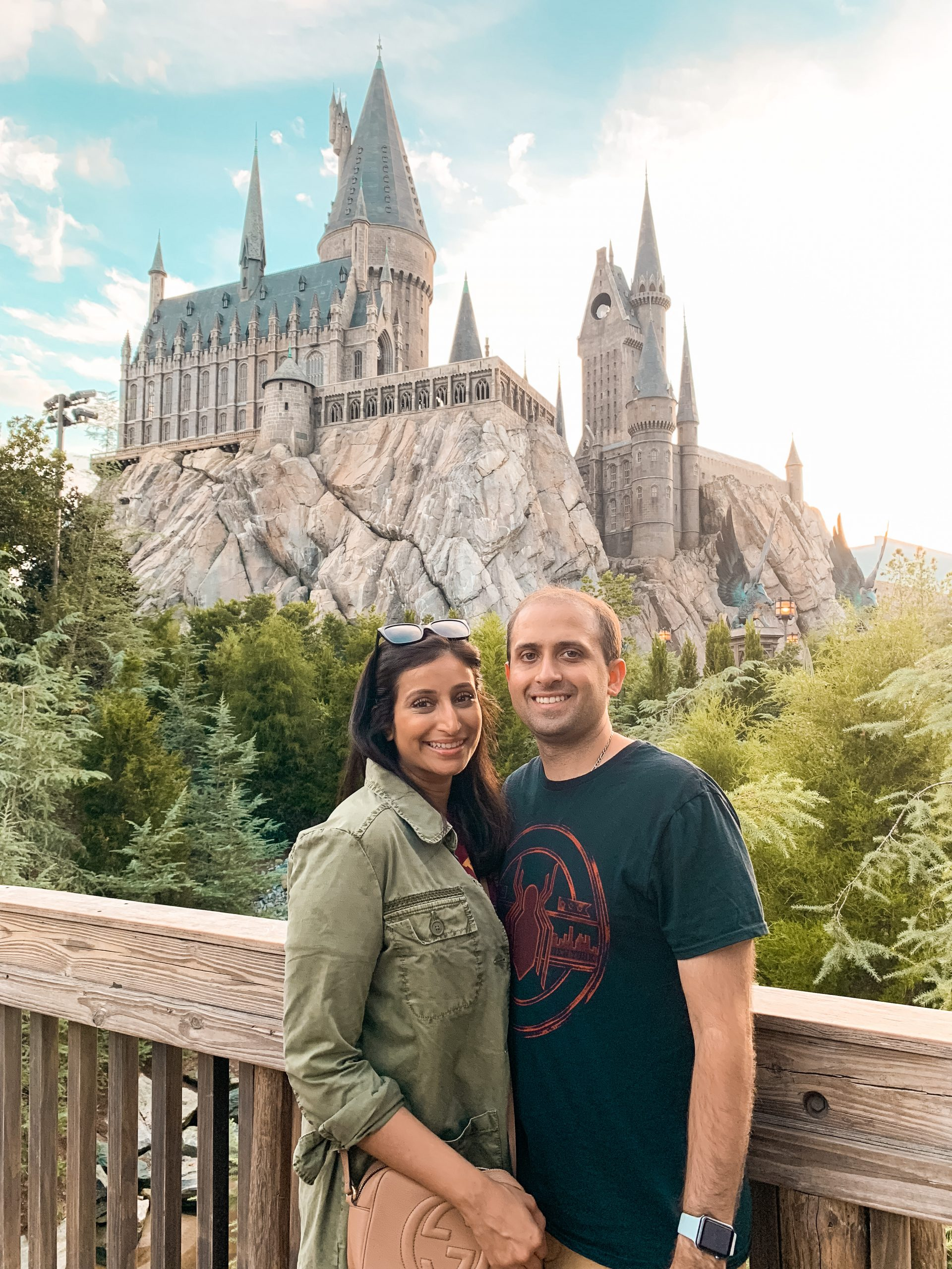 a picture of hubby and me outside Hogwarts at Wizarding World of Harry Potter