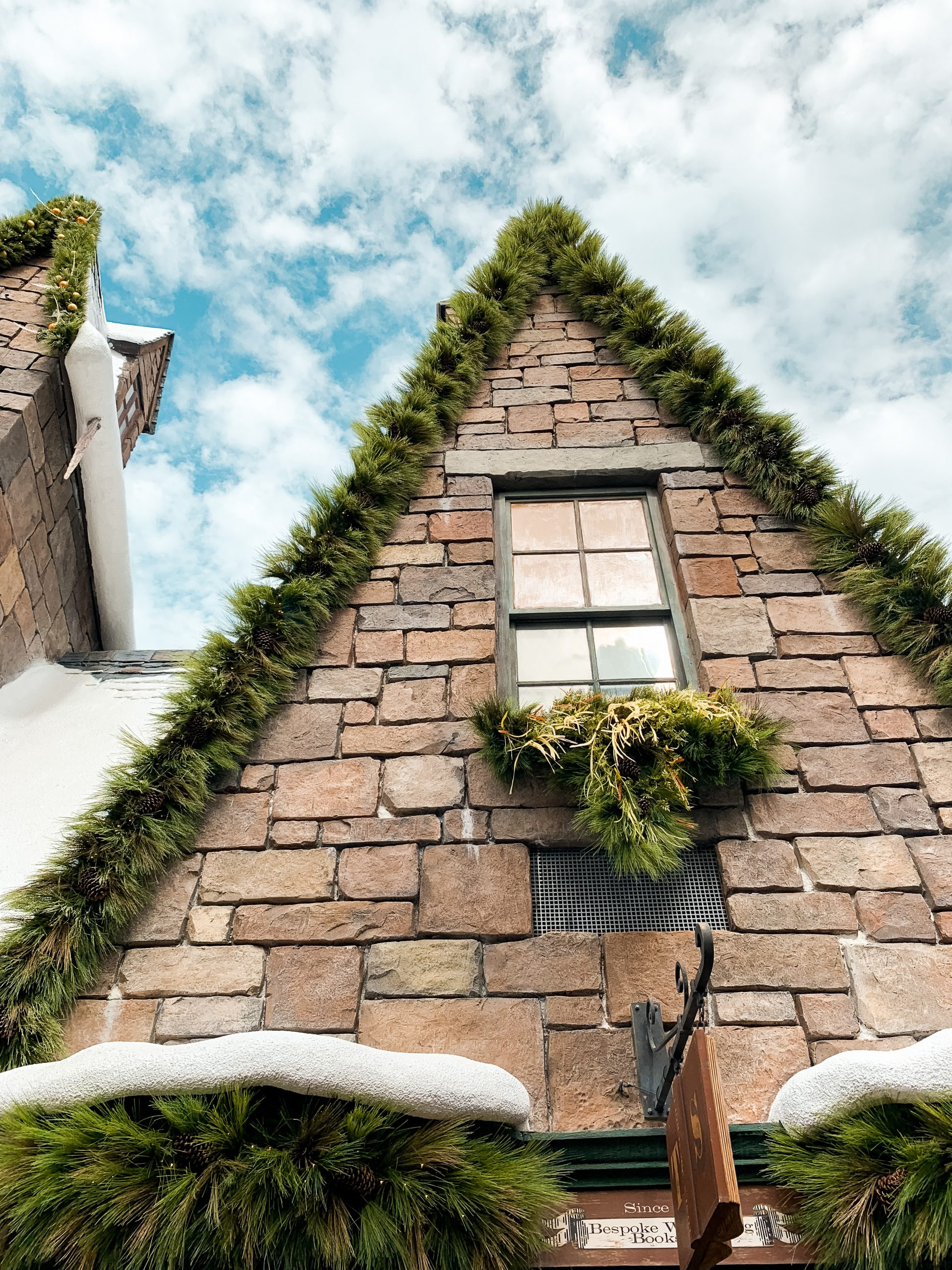 snowy store fronts In Hogmeade Wizarding World of Harry Potter