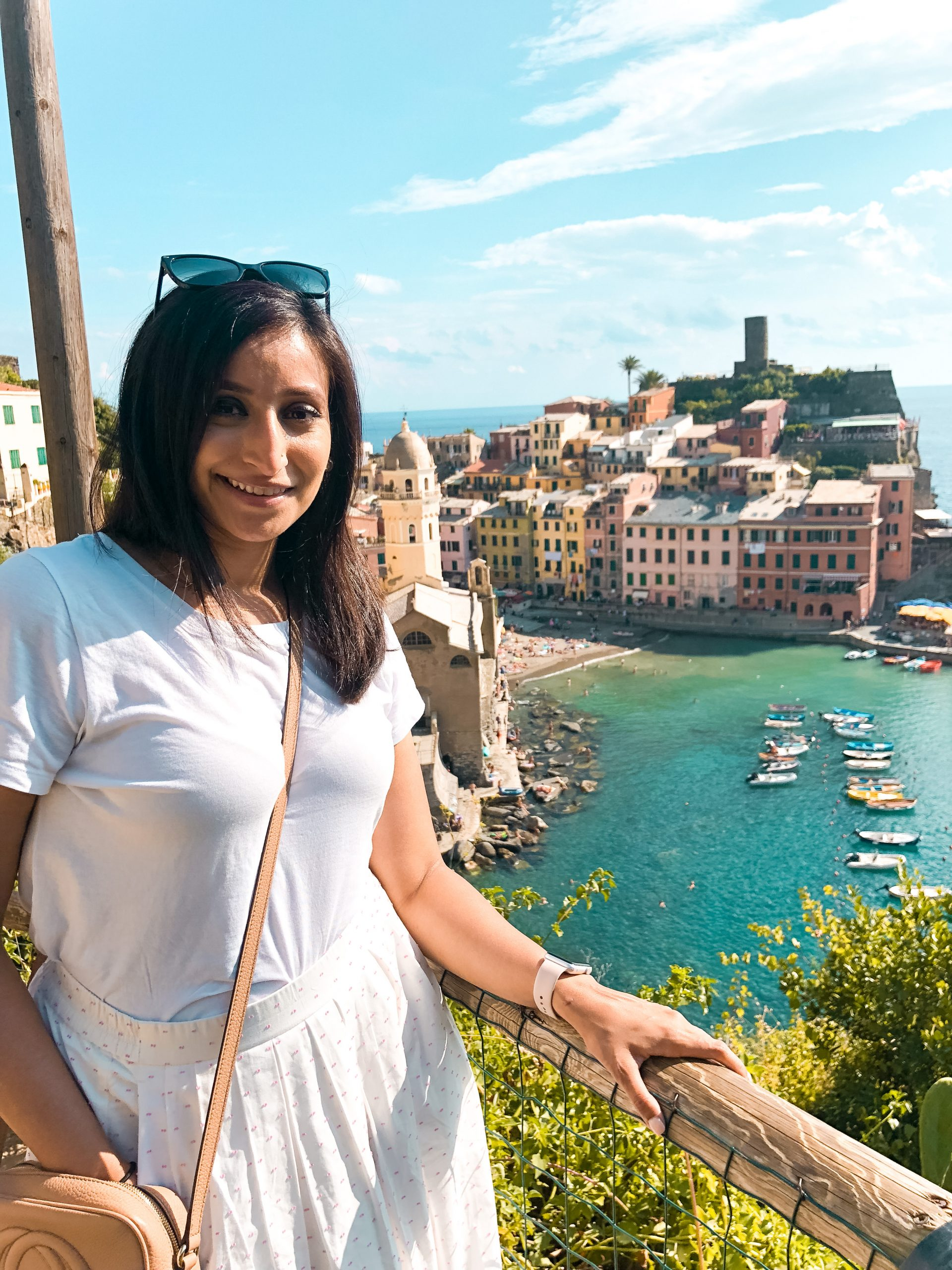 me standing with the Vernazza harbor behind me