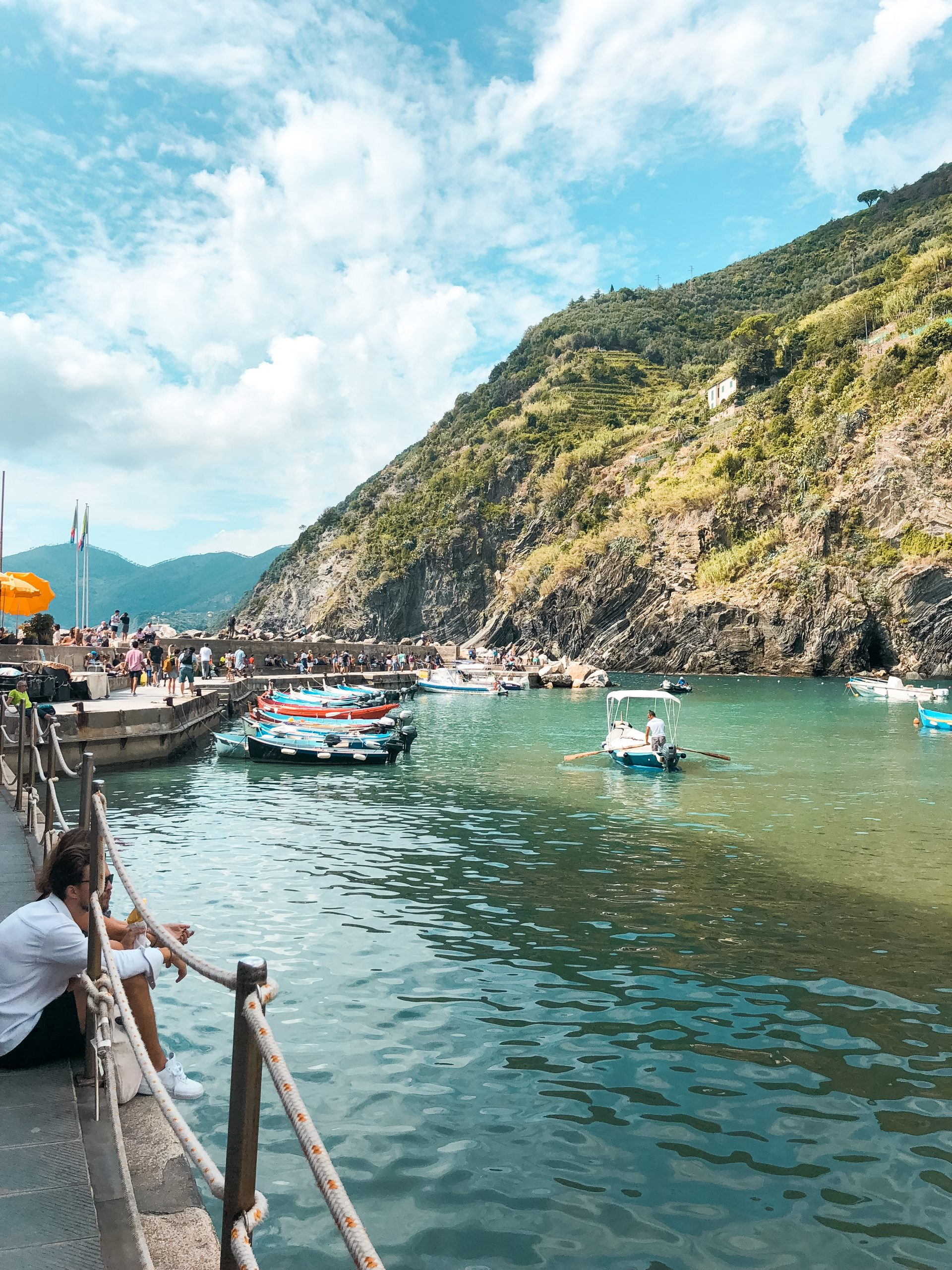 the water near Vernazza with boats and a large cliff