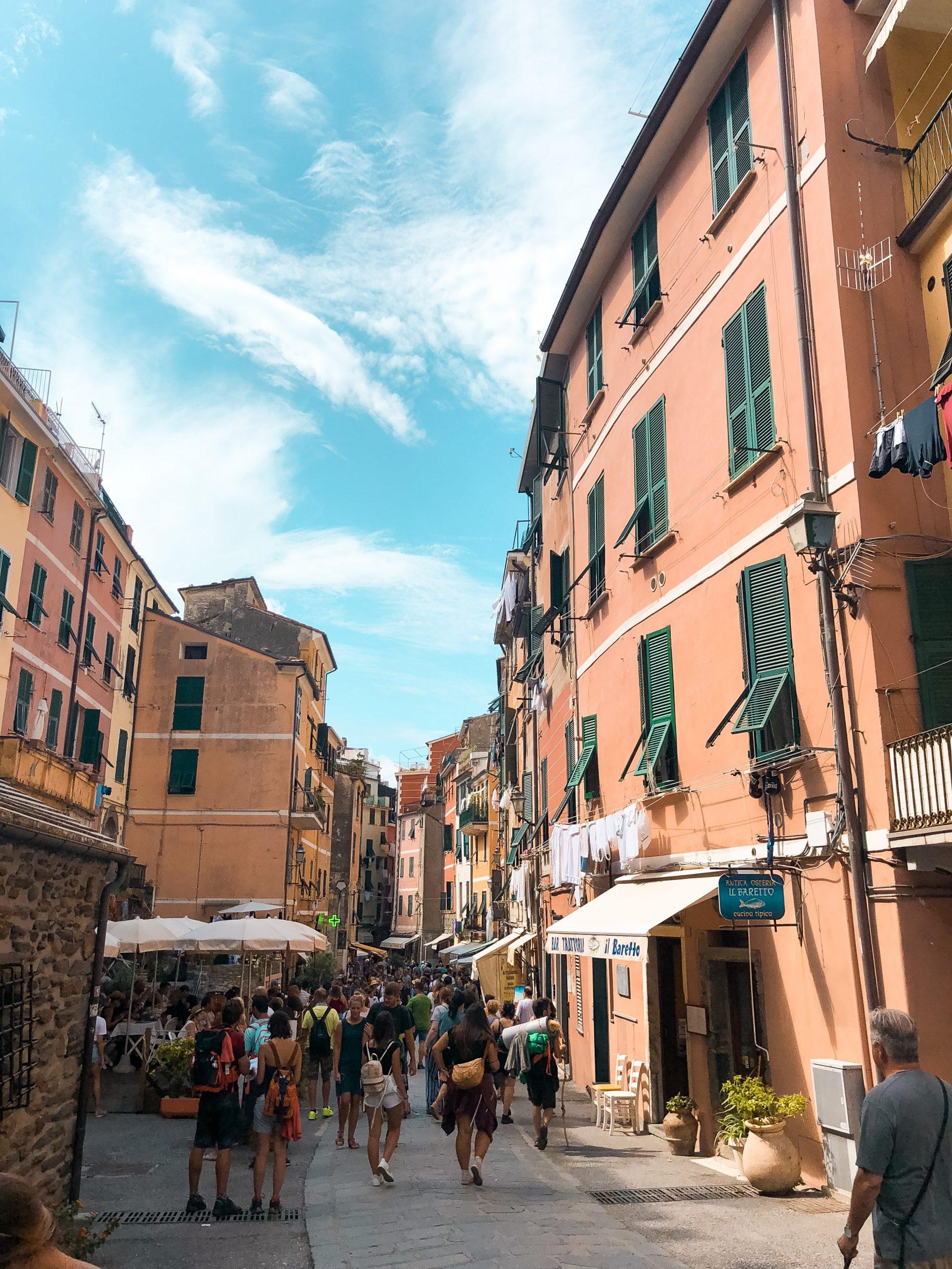 colorful buildings under a blue sky in Manarola, Cinque Terre