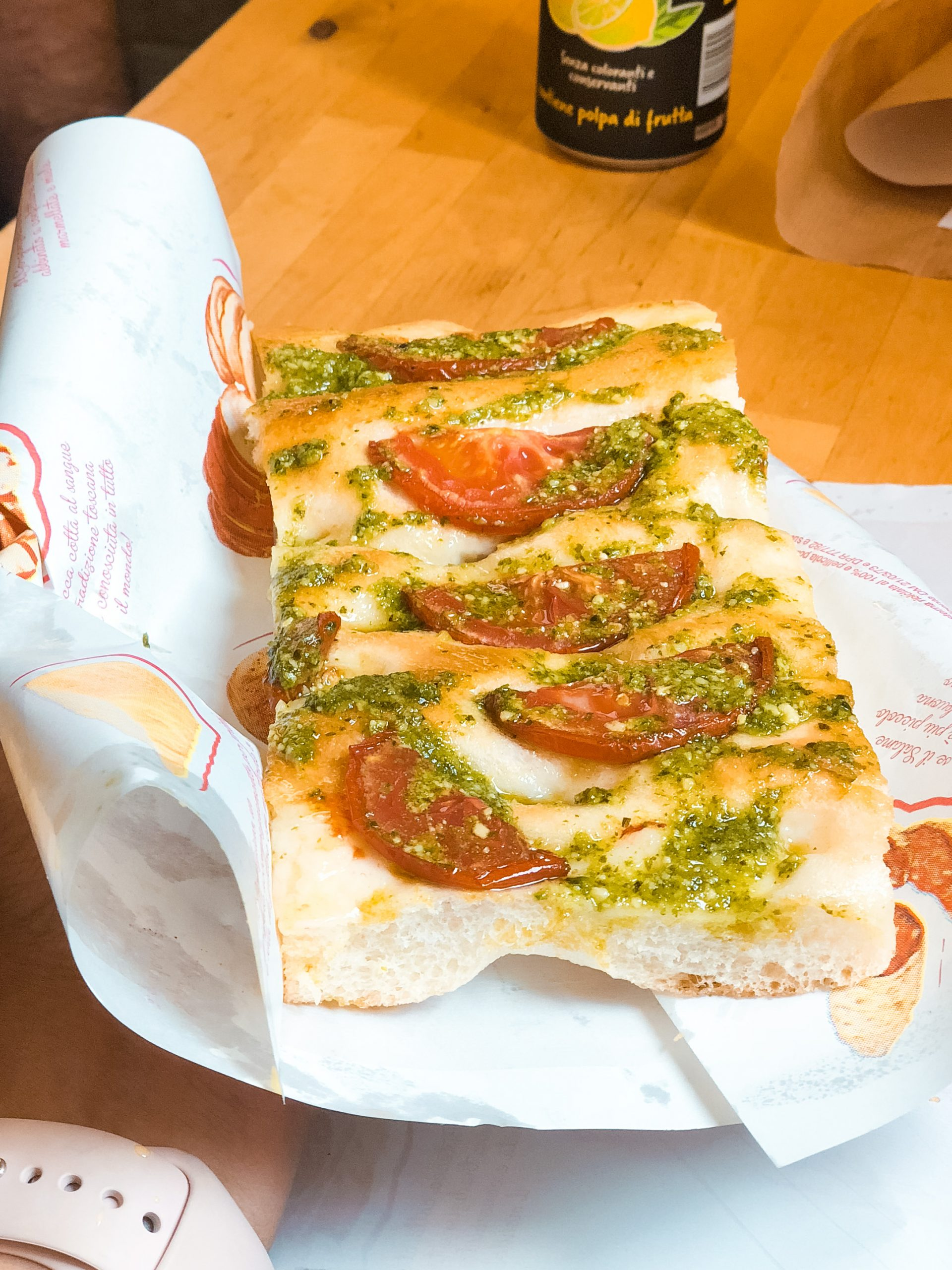 focaccia with slices of tomatoes and basil pesto