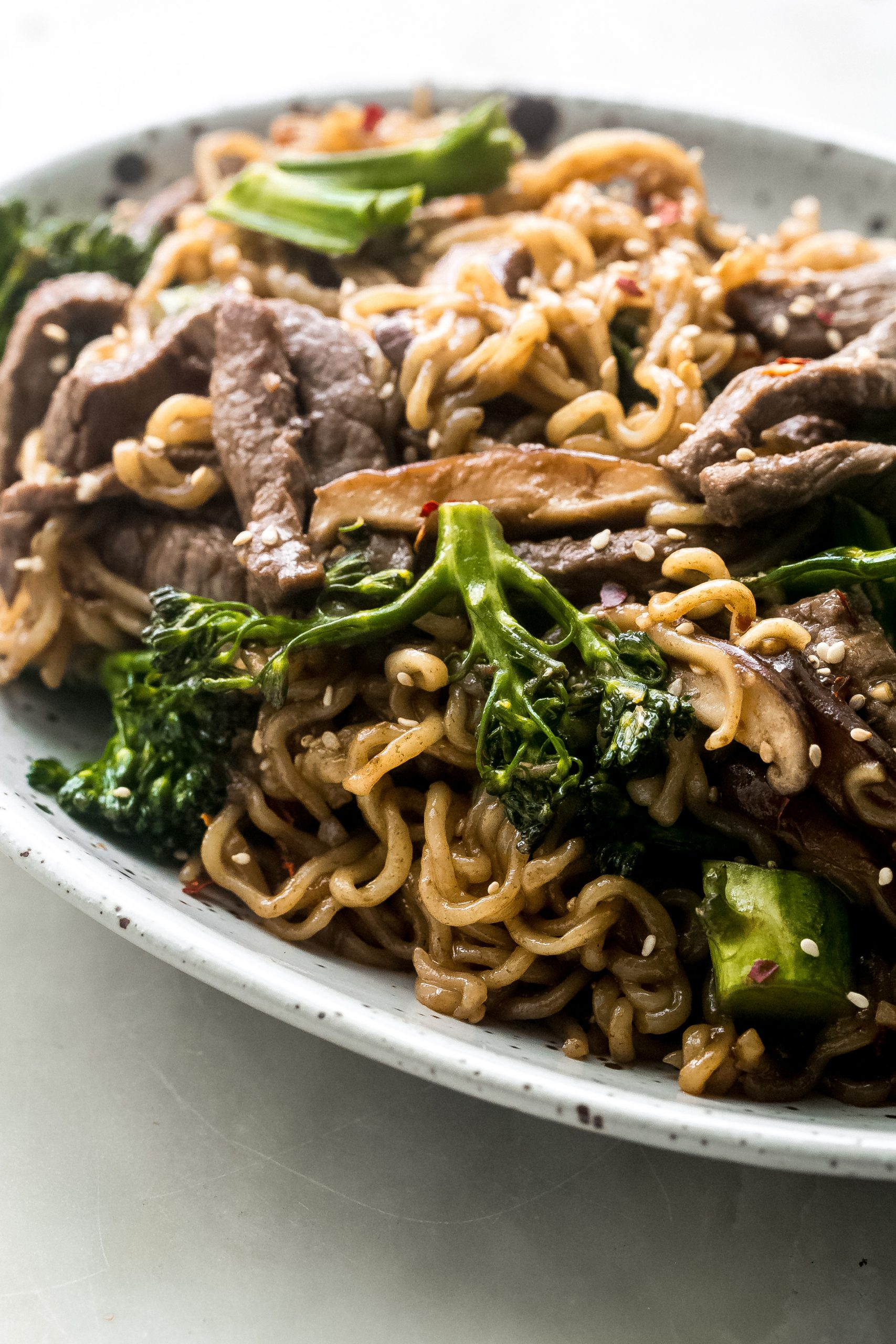 side shot of ramen noodles with beef and broccoli