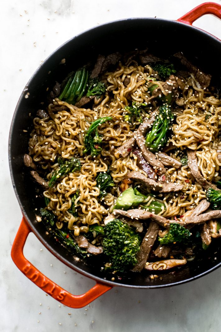 cast iron pot with ramen noodles with broccolini and sautéed beef