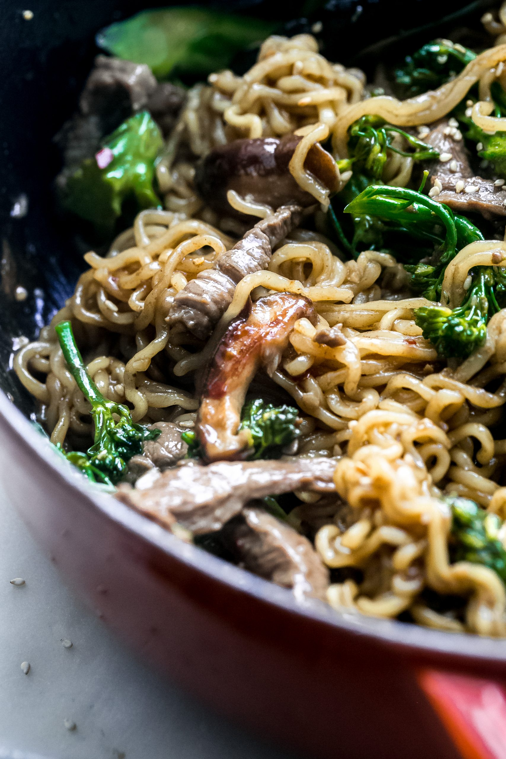 close up of sautéed beef ramen with broccolini