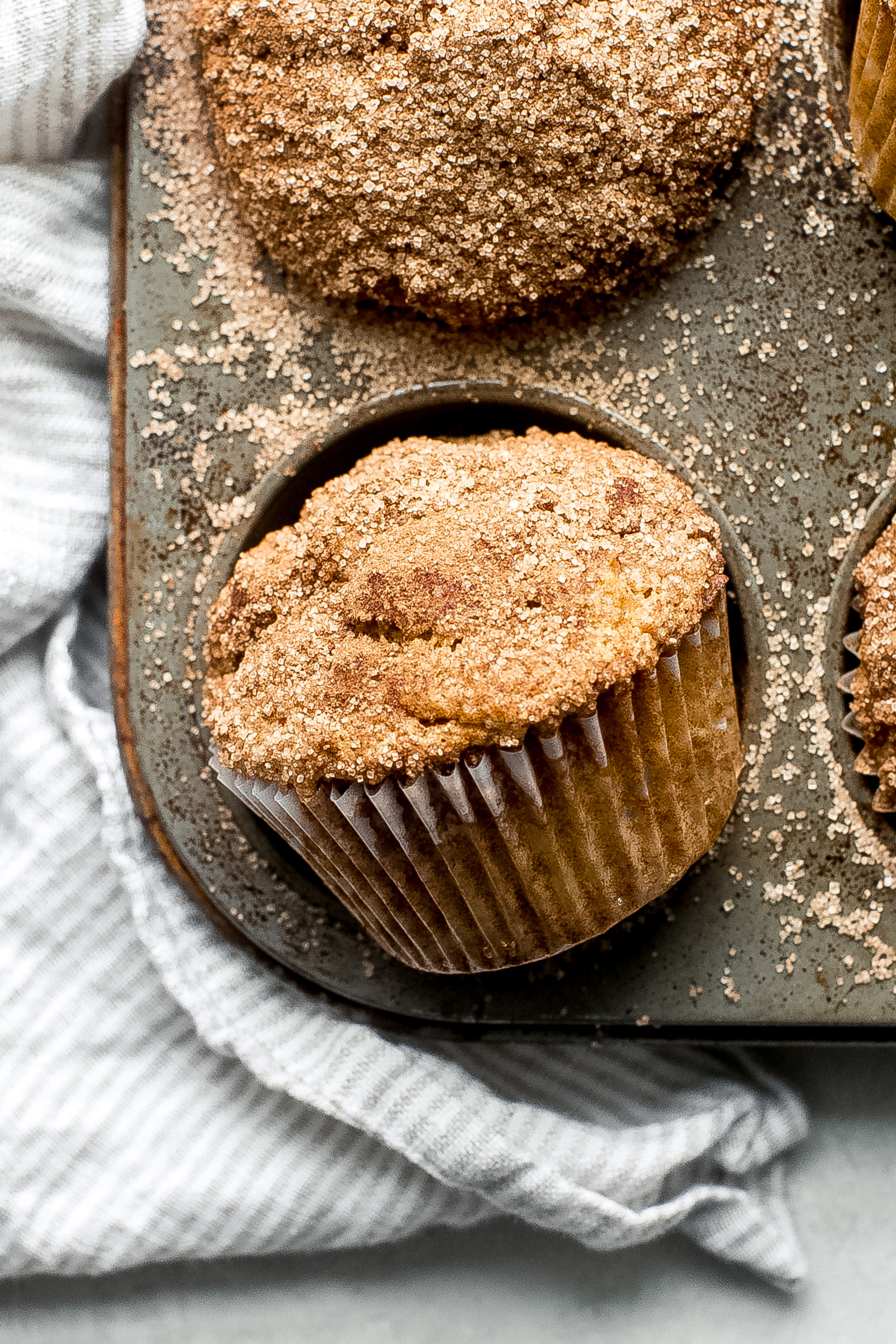 close up of pumpkin muffins showing the texture of cinnamon sugar on top