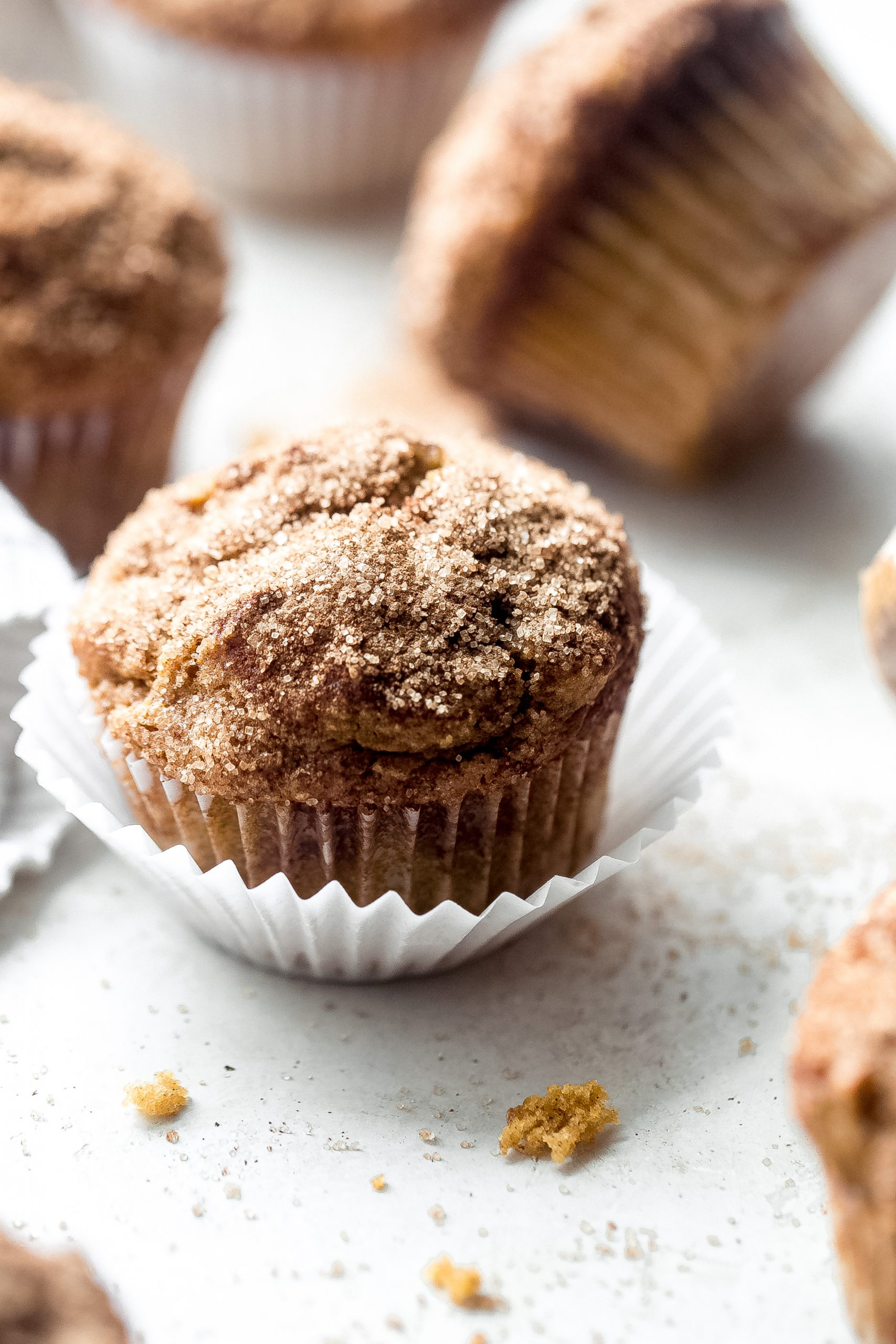 close up of pumpkin muffin sprinkled with cinnamon sugar on top