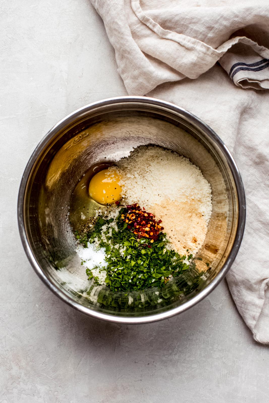 ingredients in metal bowl of meatballs