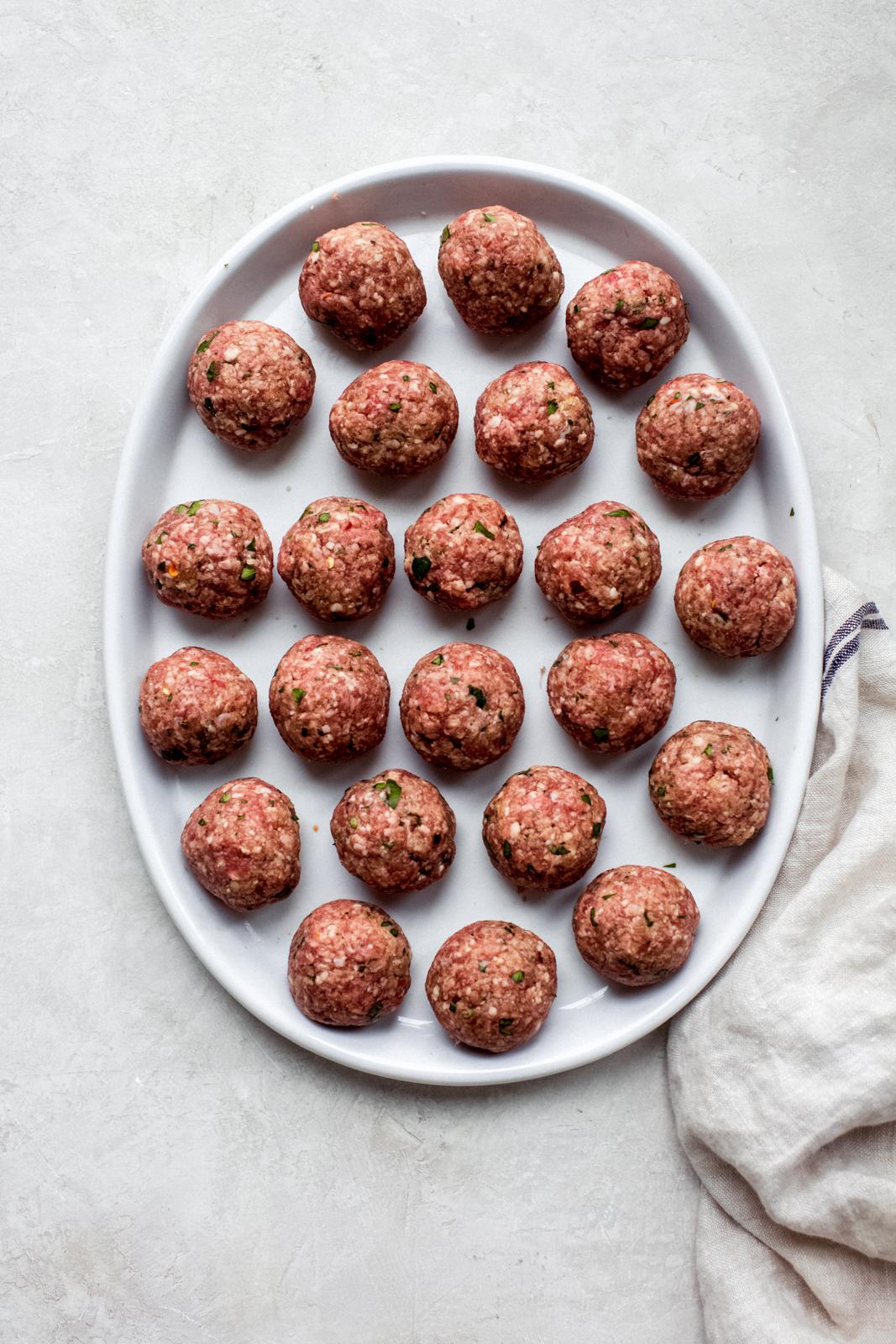 prepared meatballs on white plate