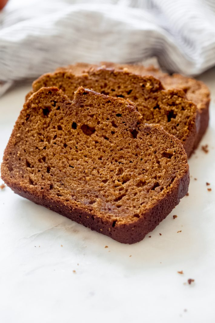 Spiced Brown Butter Pumpkin Bread - an easy recipe for pumpkin bread loaded with a toffee scent and all the fall spices! My recipe uses an entire can of pumpkin puree, leaving you with an uber tender loaf! #pumkinbread #brownbutter #pumpkinloaf #thanksgivingrecipes #pumpkinbreadrecipe | Littlespicejar.com
