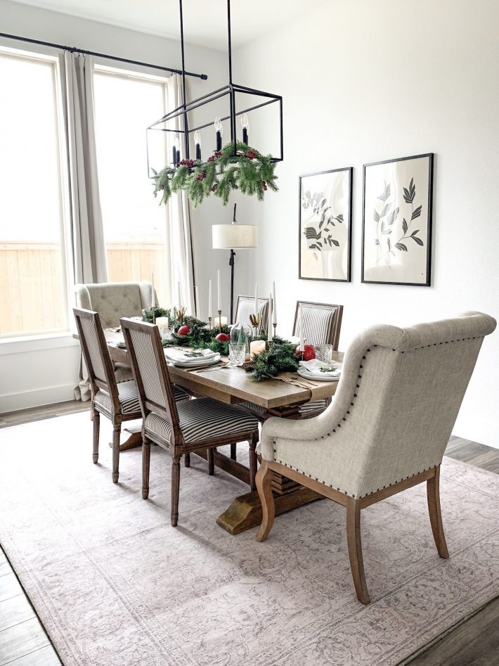 photo of festive decorated dining room with greens and reds