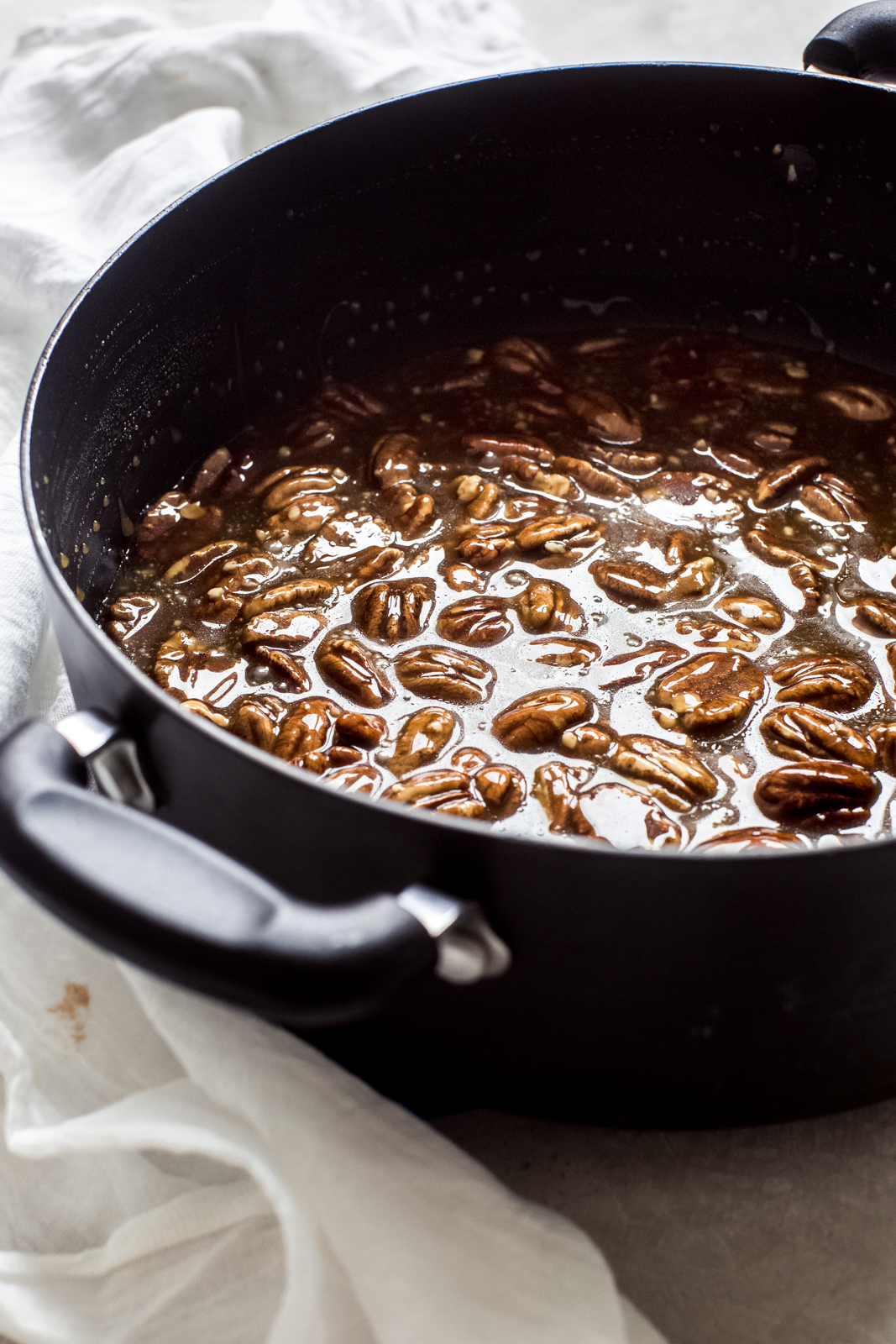 prepared pecan pie mixture in black sauce pot
