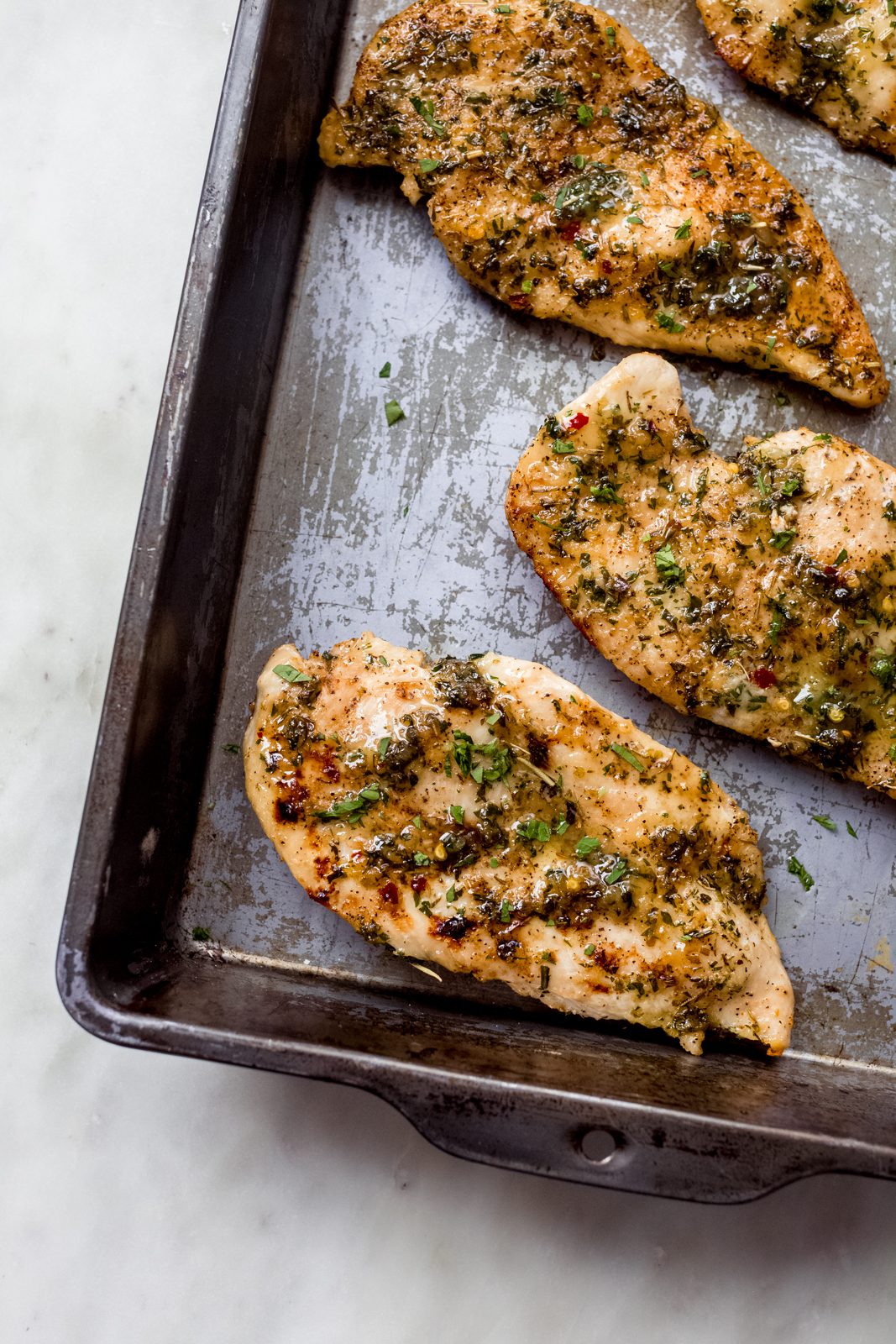 sheet pan with garlic butter baked chicken breasts
