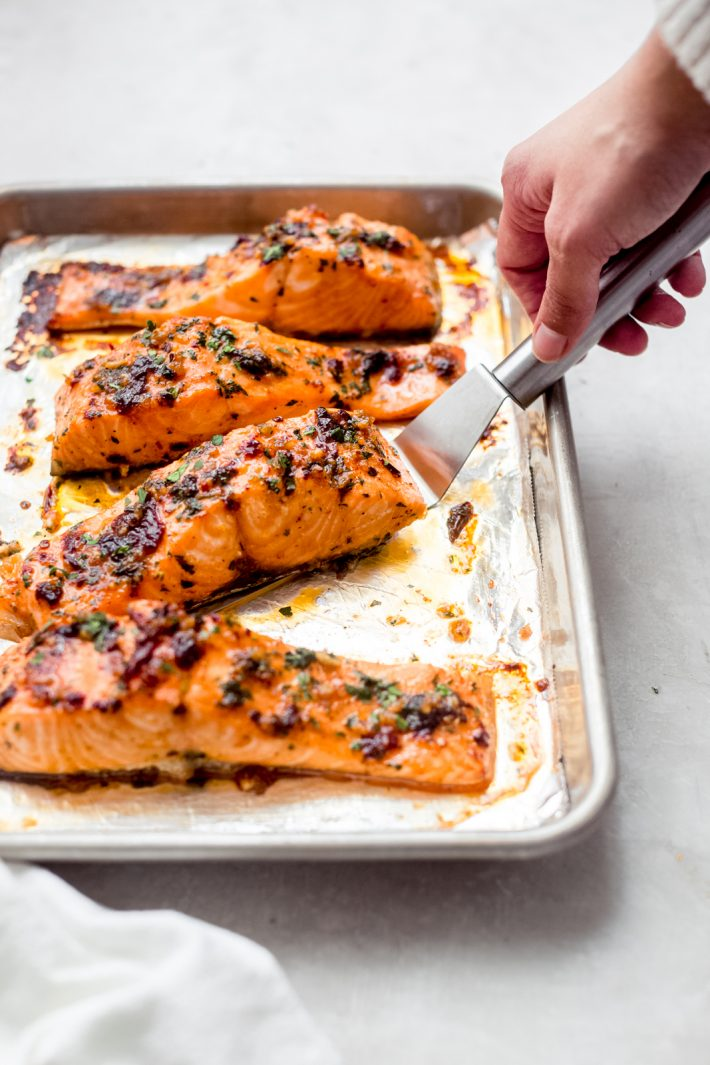 freshly roasted salmon on sheet pan
