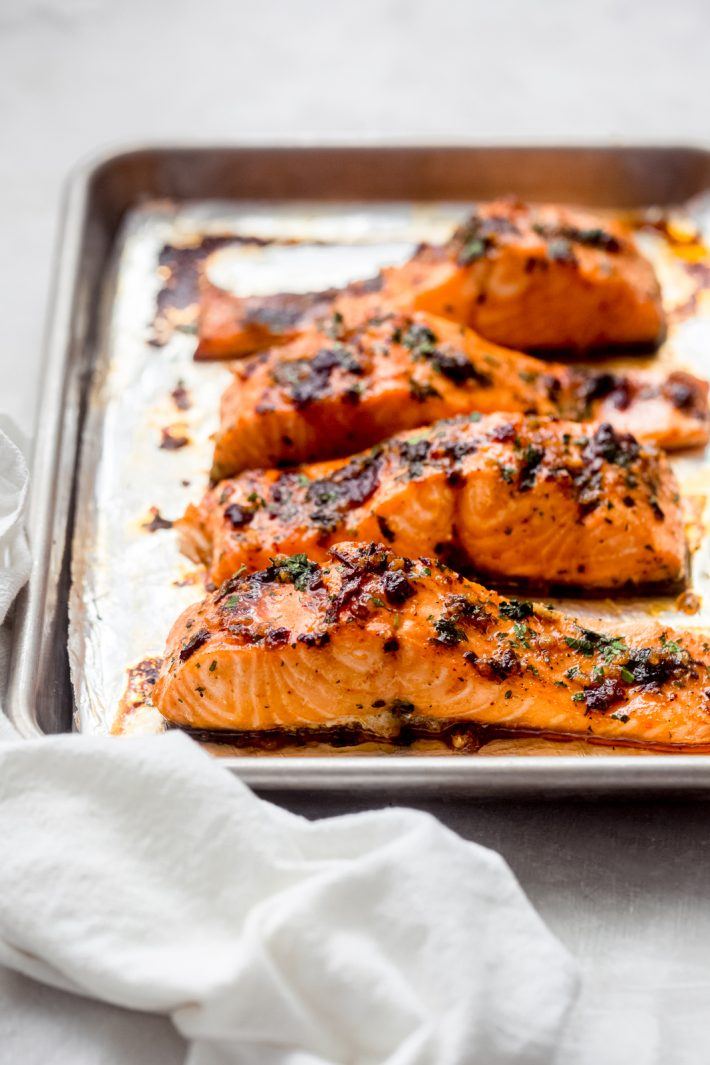 freshly roasted salmon on baking sheet