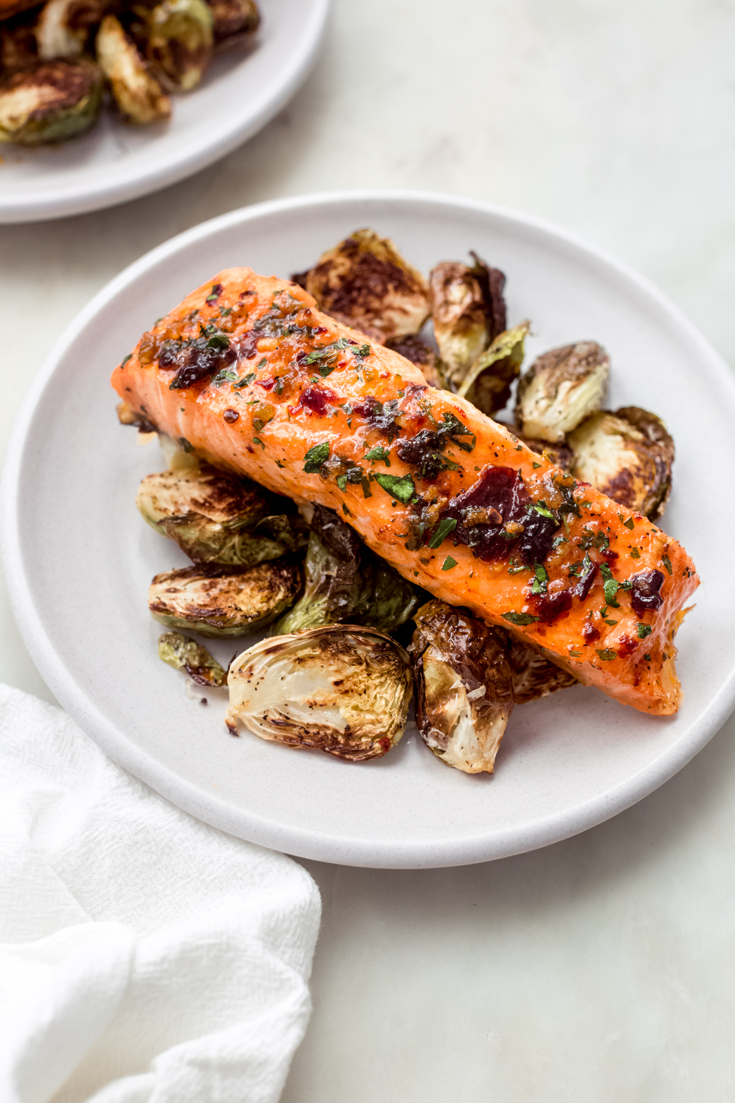 baked salmon on roasted Brussel sprouts on a plate