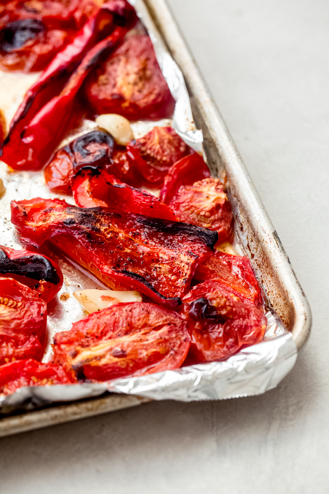 roasted red peppers on a  baking sheet tray