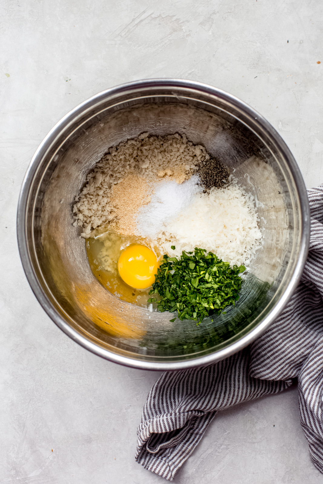 metal bowl with chicken meatballs mixture