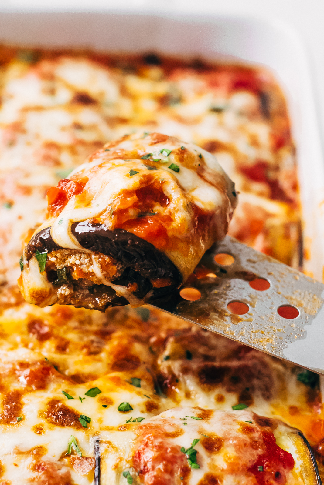 close up of eggplant roll up on spatula