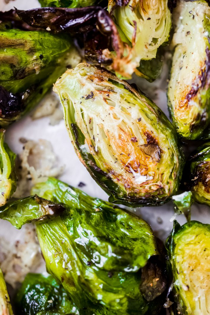 close up of roasted Brussels sprouts with pecorino cheese