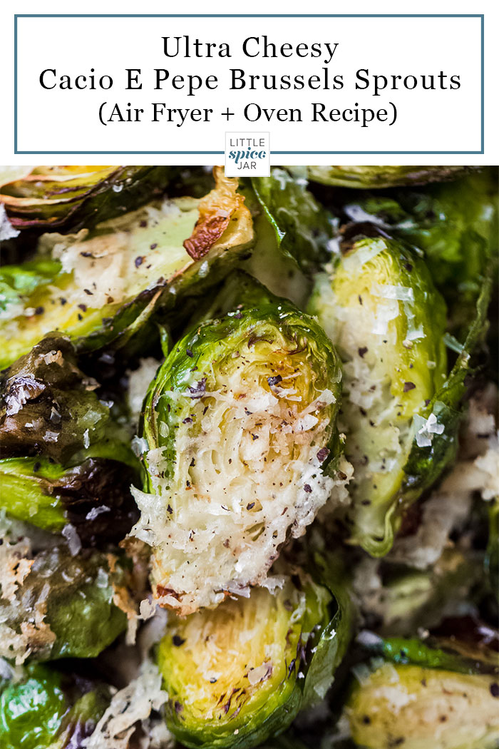 close up of roasted brussels sprouts with parmesan cheese and pepper