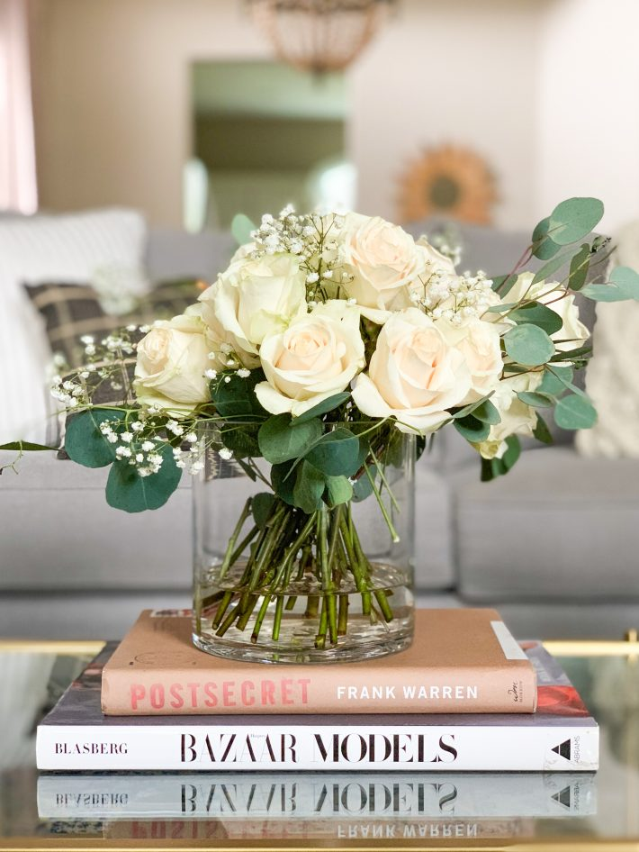 Stack of Books with Fresh Flowers