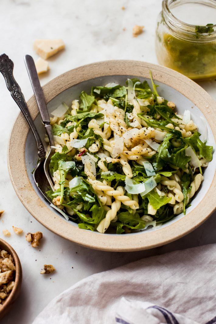 lemon basil arugula salad in a bowl