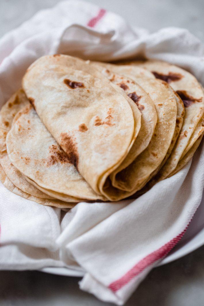 folded homemade flour tortillas
