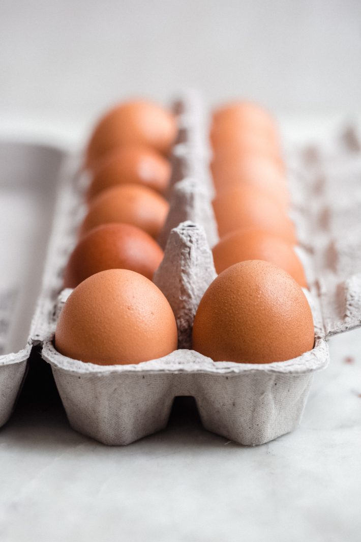 brown eggs in an egg crate