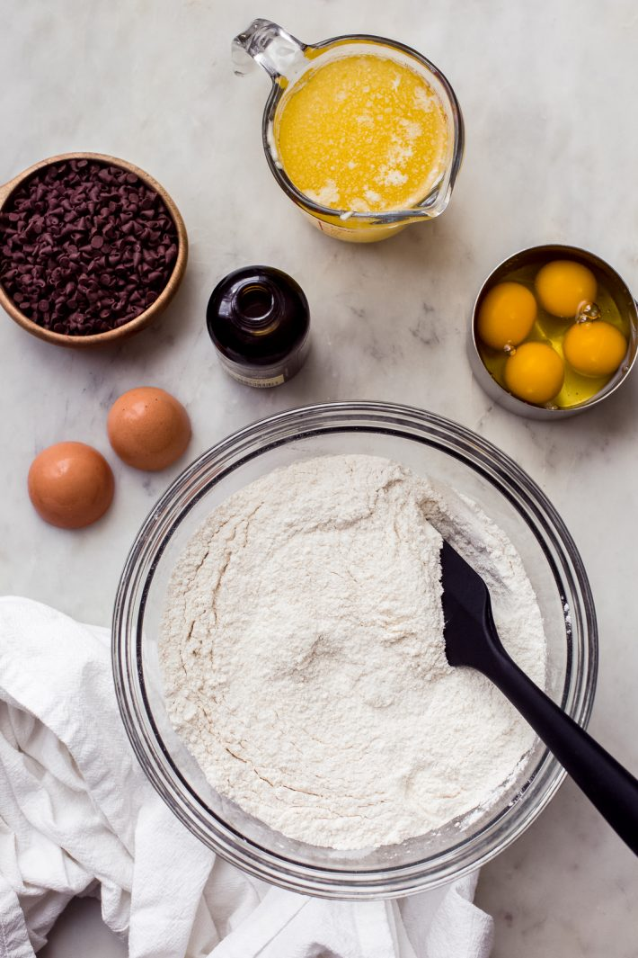 all the ingredients you need to make a vanilla bundt cake with chocolate chips