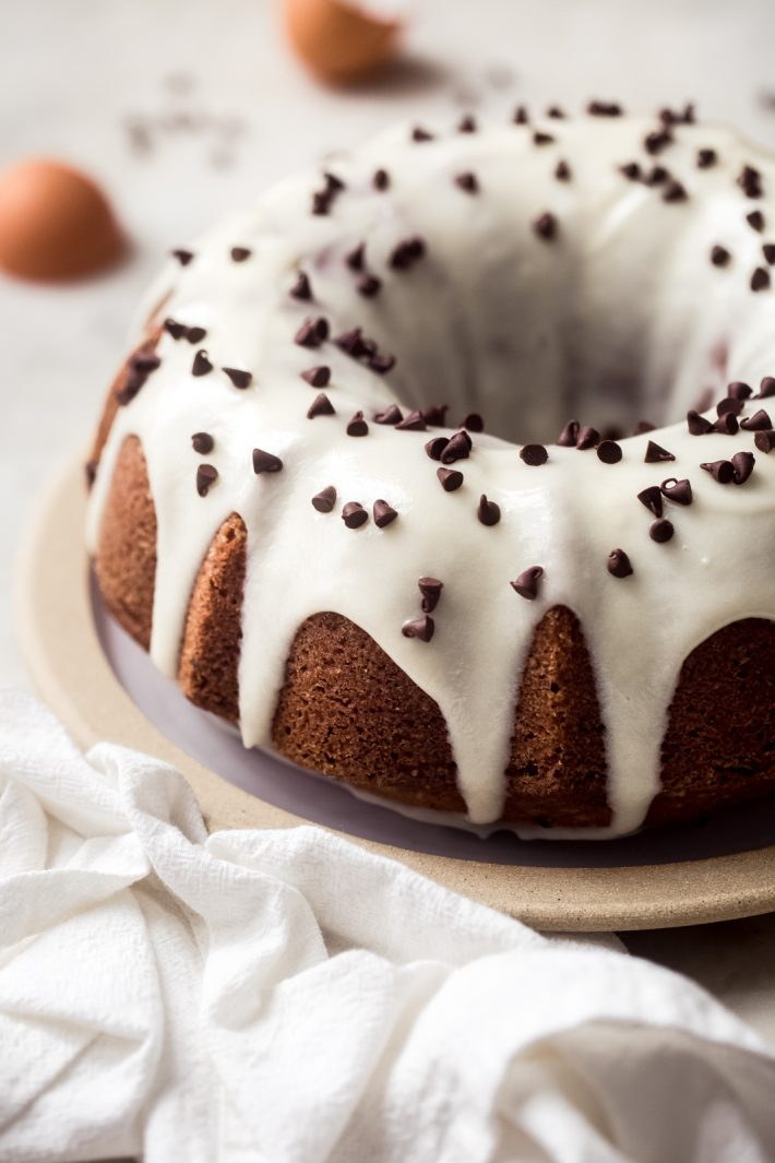 vanilla bundt cake with cream cheese icing and chocolate chips