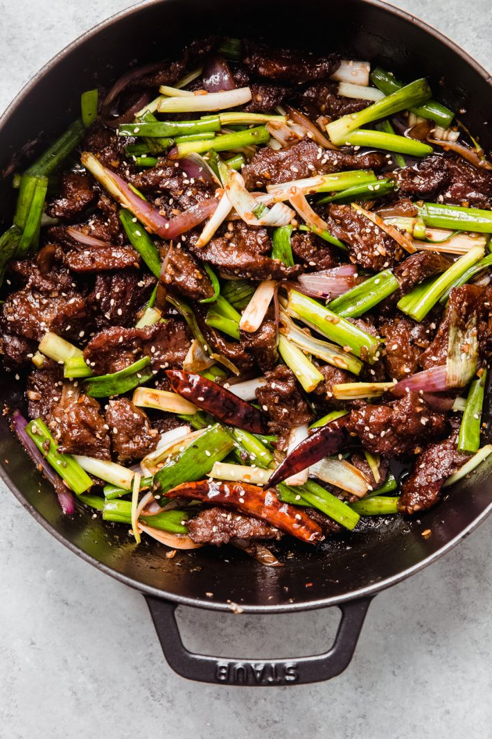 dutch oven with sautéed beef with onions and scallions