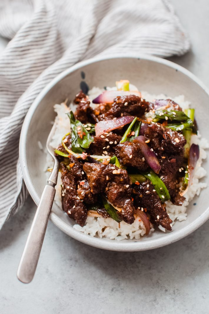 white rice with sautéed Mongolian Beef on top with a fork