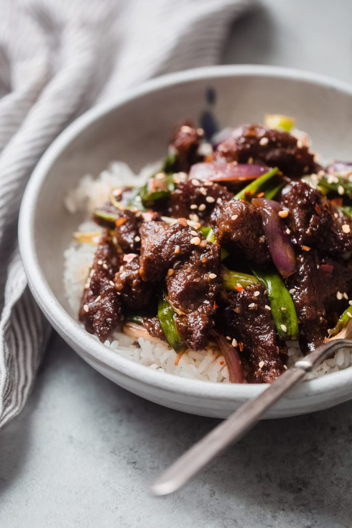 close up of jasmine rice with Mongolian Beef on top