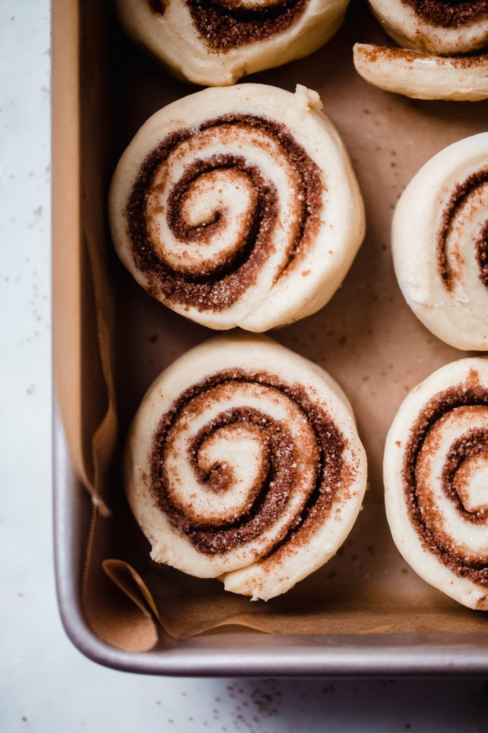 close up of unbaked cinnamon rolls showing texture of dough and cinnamon swirl