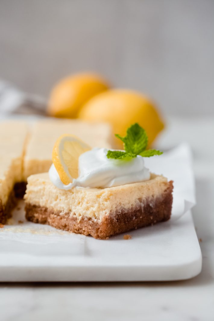 shot showing crumb texture and filling for lemon squares on marble surface