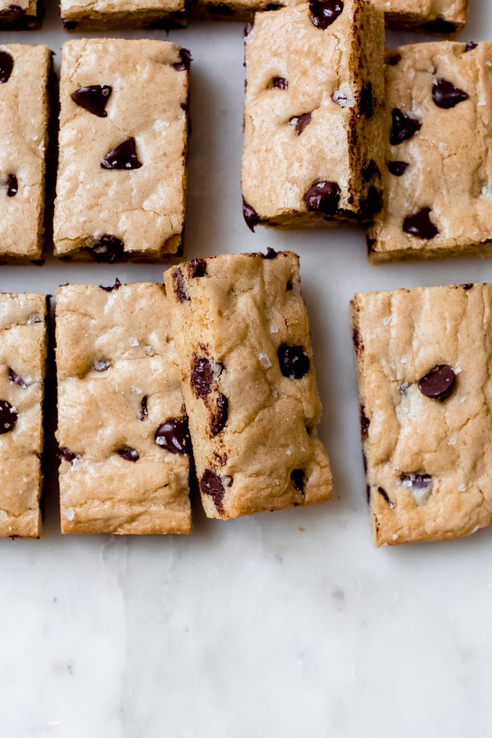 cookie bars on top ⅔ of picture on white marble surface