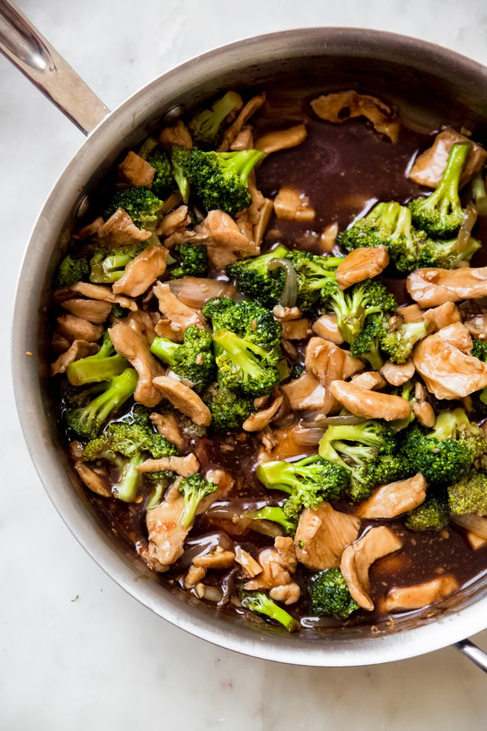 prepared chicken broccoli stir fry in skillet