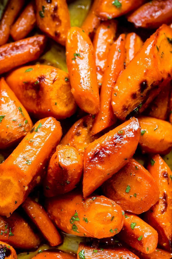 close up of roasted carrots tossed in honey garlic butter sauce