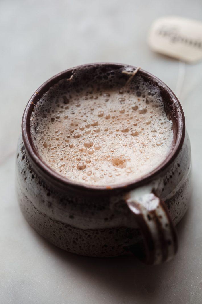 brown mug with a prepared foamy London fog latte