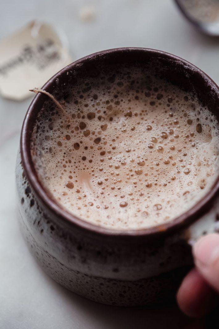 foamy milk on a latte in brown mug