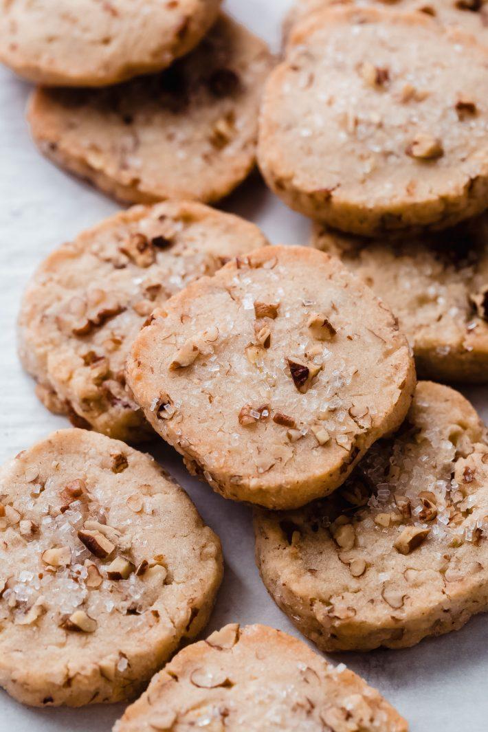 pecan shortbread cookies on white parchment paper